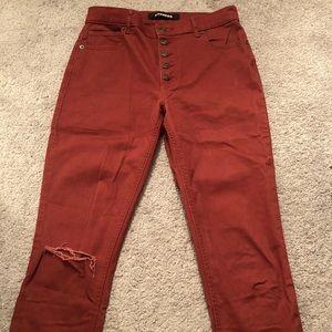 High rise button fly reddish orange skinny jeans